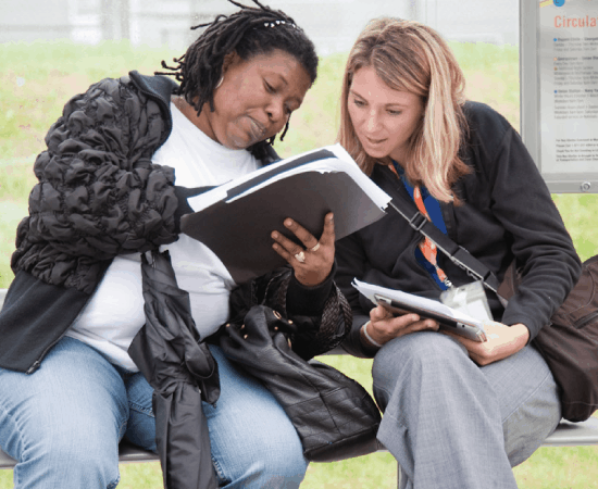 A travel trainer shows a woman how to use public transit and increase rider independence using the WMATA system.