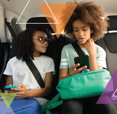 Two young girls sit in the backseat of an MTM Transit vehicle. We are committed to ensuring every trip is important and solving our clients' transit challenges.