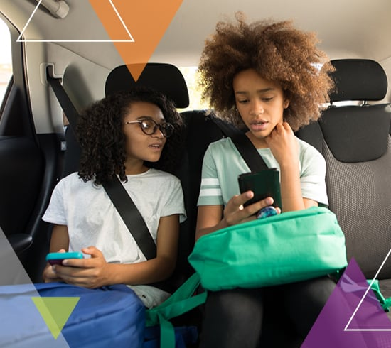 Two young girls sit in the back of a vehicle What does MTM Transit do? MTM Transit services solve transit challenges, including student and special needs transportation.