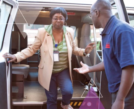 A driver holds his hand out to help a woman out of a vehicle. Through our ADA paratransit brokerage approach, MTM Transit leverages the brokerage model to increase the efficiency of paratransit fleets.