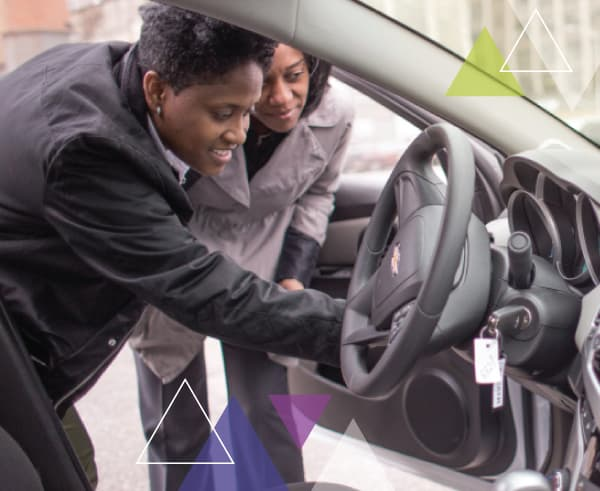 Two women perform an inspection on a vehicle, looking at the steering wheel. To increase the performance of paratransit fleets, MTM Transit utilizes the ADA paratransit brokerage approach and brokerage model.